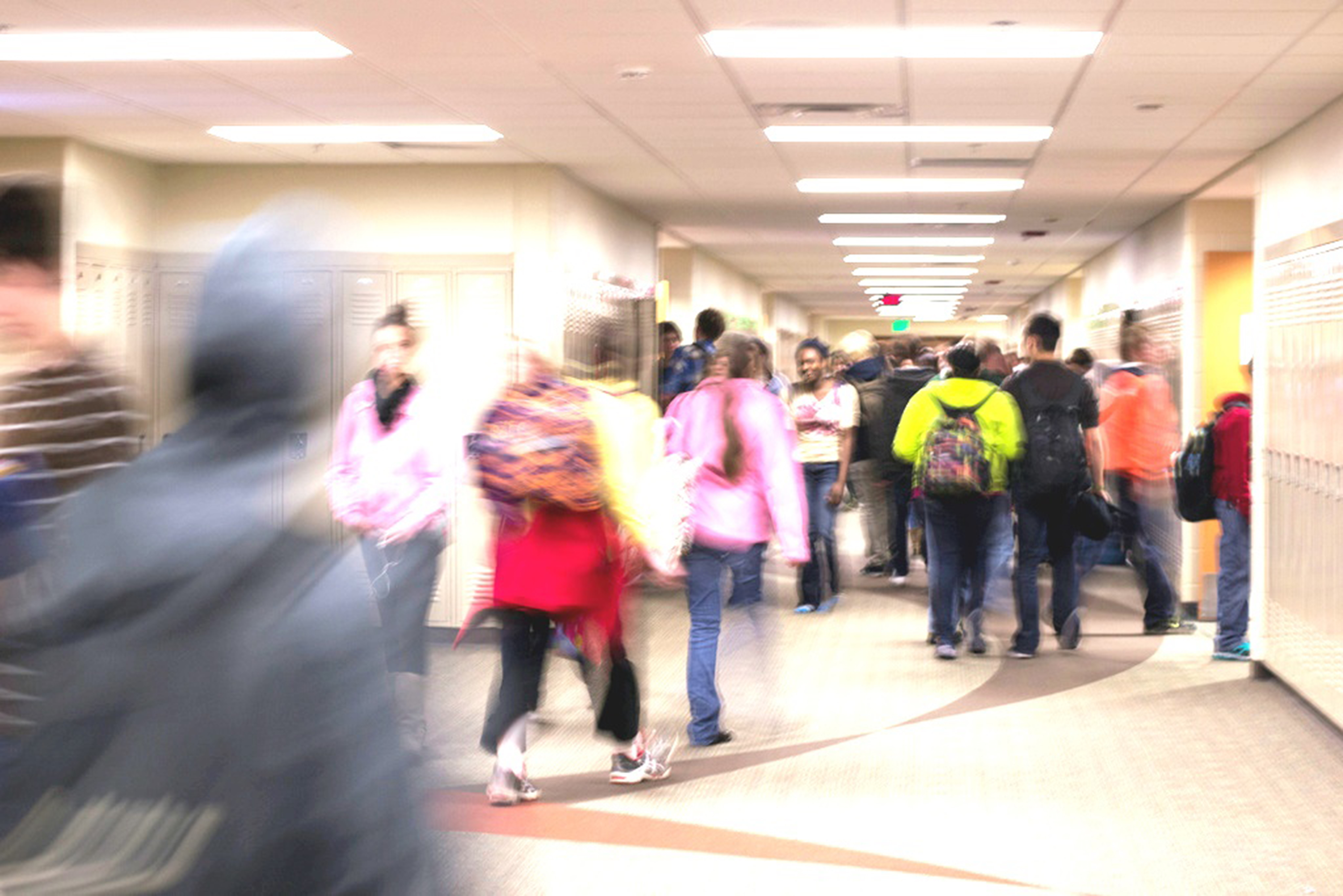Student - blurry-hallway 2