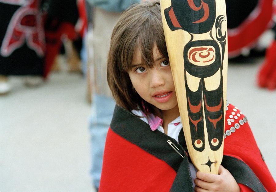 Haida Girl holding paddle