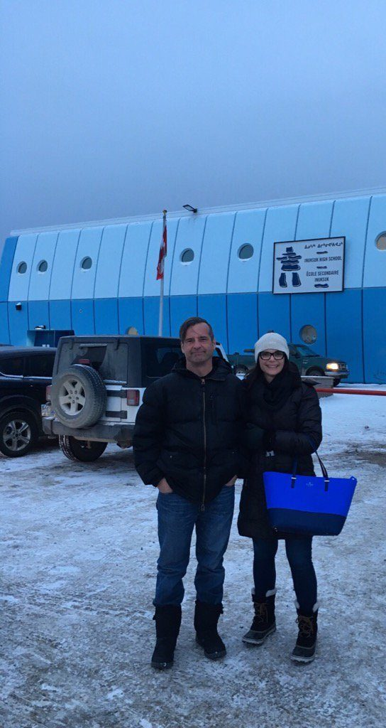 Robert Olson, Librarian & Writer, and Mara Grunau, Executive Director, in front of the high school in Iqaluit.
