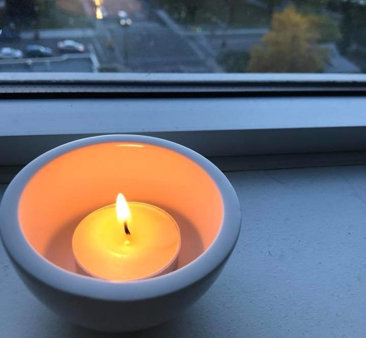 candle lit by window